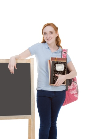 high school series: education series - Friendly Caucasian female high school student with backpack by blank blackboard with copy space