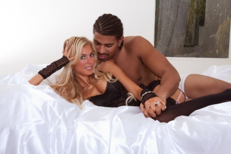 Playful sensual heterosexual couple - Caucasian woman and ethnic black man of mixed African-American and Italian ethnicity Stock Photo - 14172423