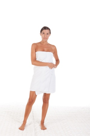 slicked: Young Caucasian woman wrapped in bath towel