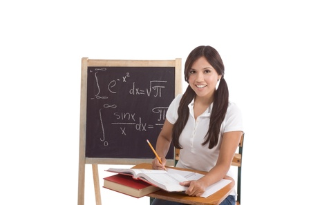 formals: Latina High school or college female student sitting by the desk at math class. Blackboard with advanced mathematical formals is visible in background