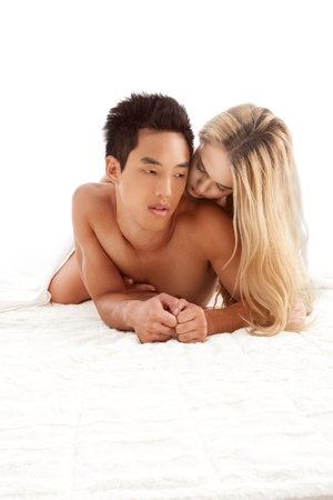 adult sex: Interracial Lovers - young sensual heterosexual couple making love. Caucasian blond woman and Asian Chinese man