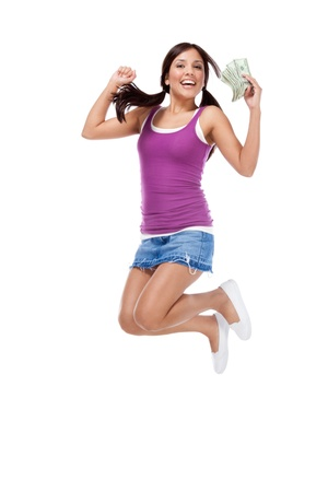 education back to school series - Friendly ethnic Latina woman high school student with pile of 100 dollars money bills in jeans skirt jumping in excitement Stock Photo - 16711410