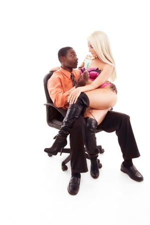 Caucasian exotic dancer performing striptease lap dance for Ethnic black African American businessman sitting on office chair Archivio Fotografico