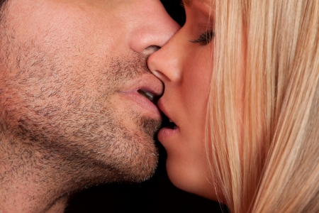 love kiss of young sexy heterosexual sensual couple photo