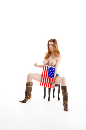 Topless Caucasian woman holding American flag