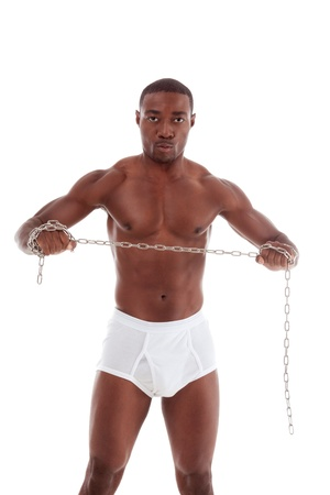 underpants: Young handsome Athletic muscular ethnic black Afro-American man exercising with chain Stock Photo