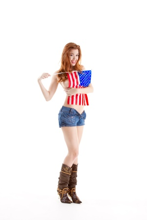 Topless Caucasian woman holding American flag photo