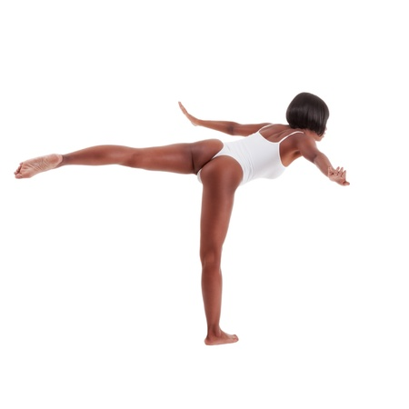 spread legs: black ethnic African-American gymnastics ballet dancer woman in white one piece leotard Stock Photo