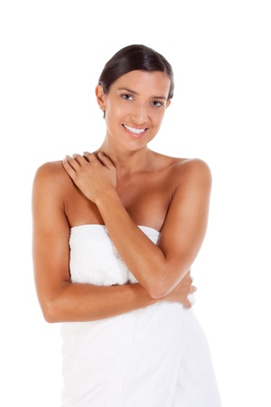 slicked back hair: Young Caucasian woman wrapped in bath towel