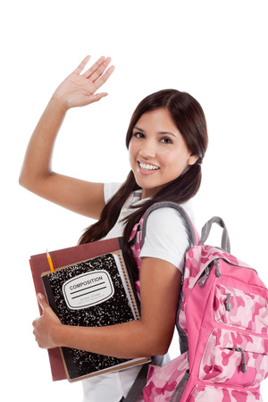 high school series: education series - Friendly ethnic Latina female high school student with backpack and composition book, gesturing and greeting