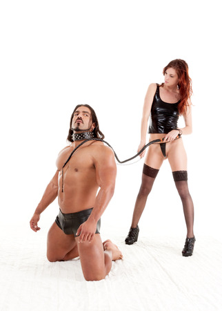 sensual lovers couple masculine barbarian Italian man and biracial redhead dominatrix woman engaging in BDSM photo