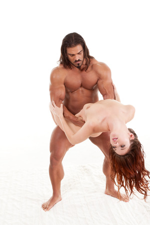 sensual lovers couple Italian man and biracial redhead woman making love Stock Photo - 27056289