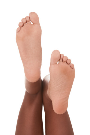 black toes: Feet of ethnic black African-American woman Stock Photo