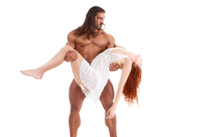Naked barbarian pirate picked up and carrying in arms body of dead, injured or sleeping lover woman Stock Photo