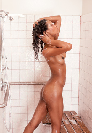 nude: biracial (mix of African-American, German-Jewish, English, Irish, French, and Native American ethnicity) nude female in shower Stock Photo
