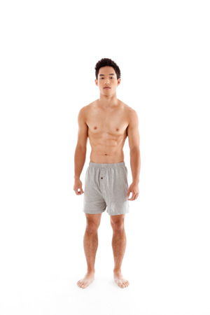 Young seminude Handsome Asian Chinese man in boxers underwear photo