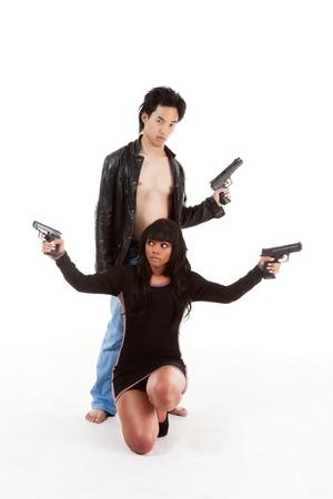 Couple Asian man biracial black Hispanic Latina Puerto Rican woman detective secret agent criminal with gun on shooting alert Banque d'images