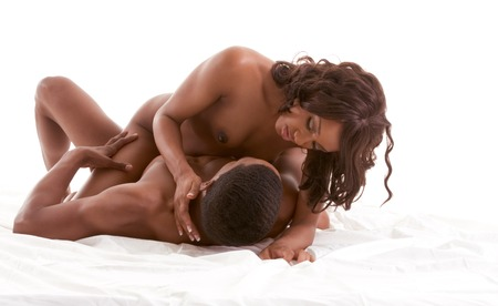 adult sex: Lovers - African-American black sensual couple making love in bed