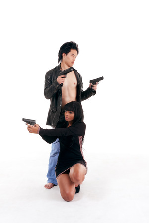 Couple Asian man biracial black Hispanic Latina Puerto Rican woman detective secret agent criminal with gun on shooting alert photo