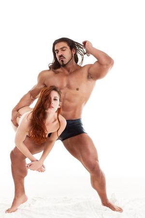 sensual lovers couple Italian man and biracial redhead woman making love photo