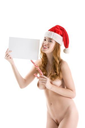 young nude girl: Sinnlich sexy nude kaukasischen Frau Santa Claus in Weihnachtsm�tze mit leeren Papier copyspace Lizenzfreie Bilder