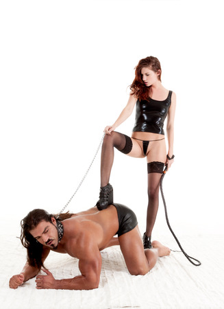 sensual lovers couple masculine barbarian Italian man and biracial redhead dominatrix woman engaging in BDSM