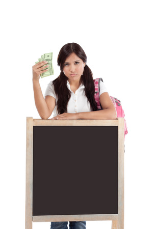 exuberant: Ethnic Hispanic college student with notebook and backpack holds pile 100 (one hundred) dollar bills happy getting money frustrated by exuberant raising tuition cost and unaffordable education forcing into debt Stock Photo