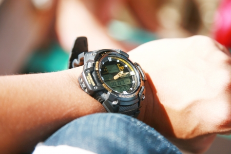 Watch on the man arm