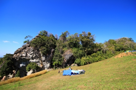 Big tent with big hill and blue sky