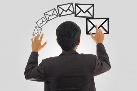 A man sending E-mail Stock Photo