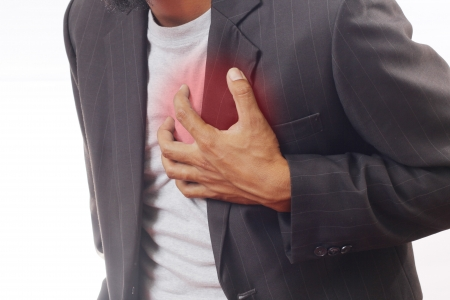 heart attack: A man have heartache in isolated Stock Photo