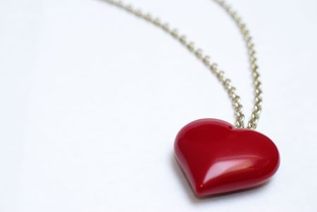 A necklace with a large heart-shaped pendant on white background.