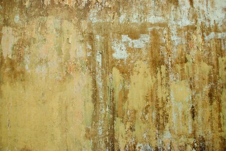 A dirty grunge wall with cracked, peeling paint and rusty texture.