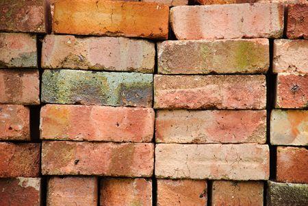 Unused bricks stacked outdoors.