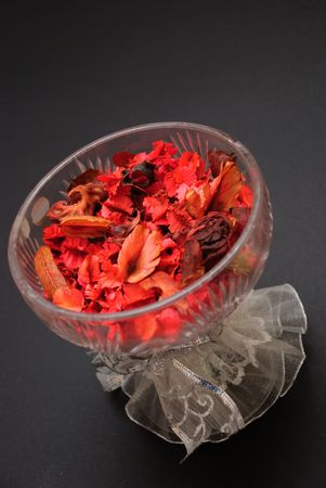 Red potpourri in crystal bowl Stock Photo