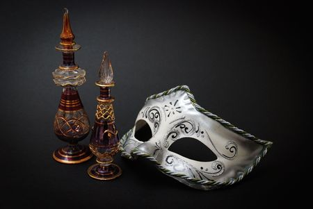 Two Venetian Glass jugs and a Venetian mask on black background