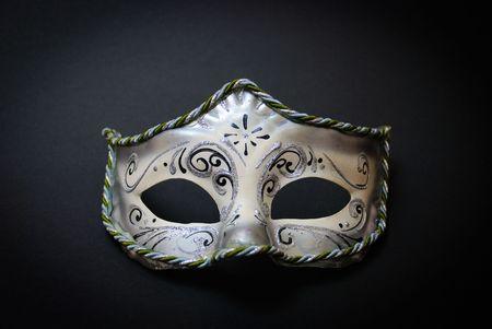 A white Venetian Mask on black background Stock Photo