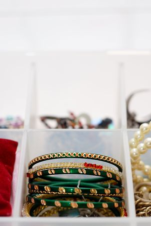 Green bangles in a jewelry box