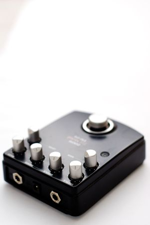 jack in a box: A black distortion pedal for guitars, on a white background Stock Photo