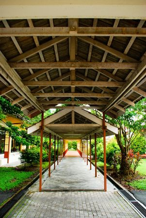 A walkway that crosses through a garden, with wooden beams