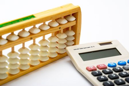 Traditional abacus and modern calculator on white background Stock Photo