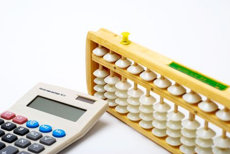 Traditional abacus and modern calculator