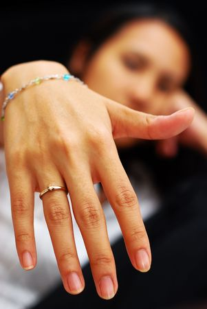 A woman showing her wedding ring to the camera Stock Photo