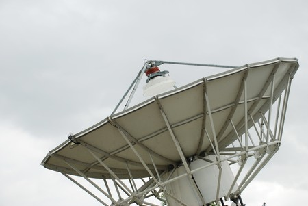 Closeup of satellite dish pointing to sky Stock Photo