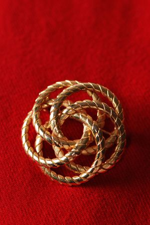 Gold plated brooch with spiral and floral pattern