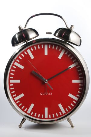 Old style red faced alarm clock with real alarm bells