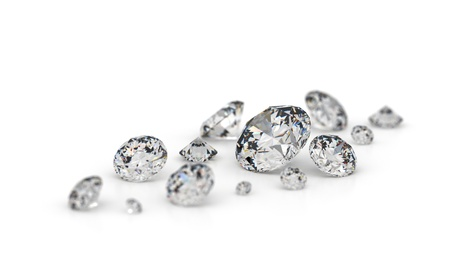 several: Several diamonds on a white background. Focus on the largest stone.  Stock Photo