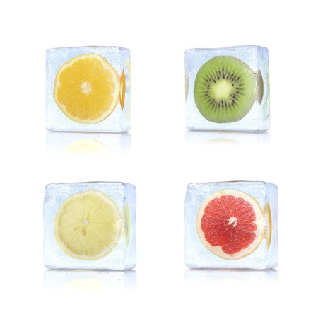 frozen fruit: Slice of citrus in the ice cubes on white background. Stock Photo