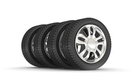 Four automobile wheels row on the white. photo