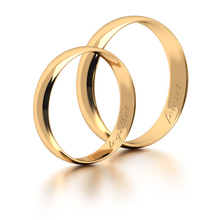 forever: Gold wedding rings engraved with the text forever together. Stock Photo